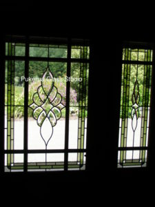 Stained glass door panel and sidelight with bevel clusters