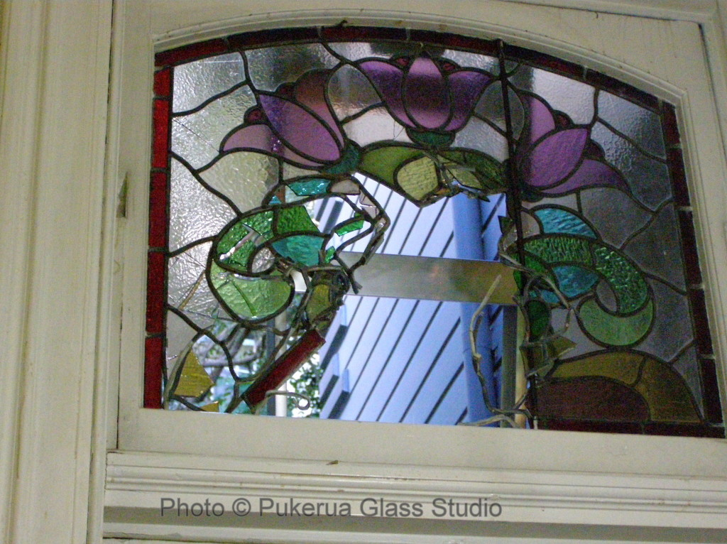Damaged stained glass window