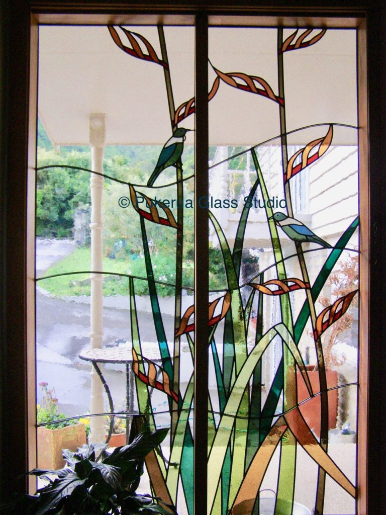 Stained glass window showing tui birds