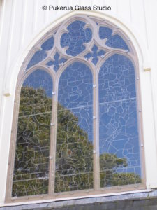 Heritage stained glass window protected