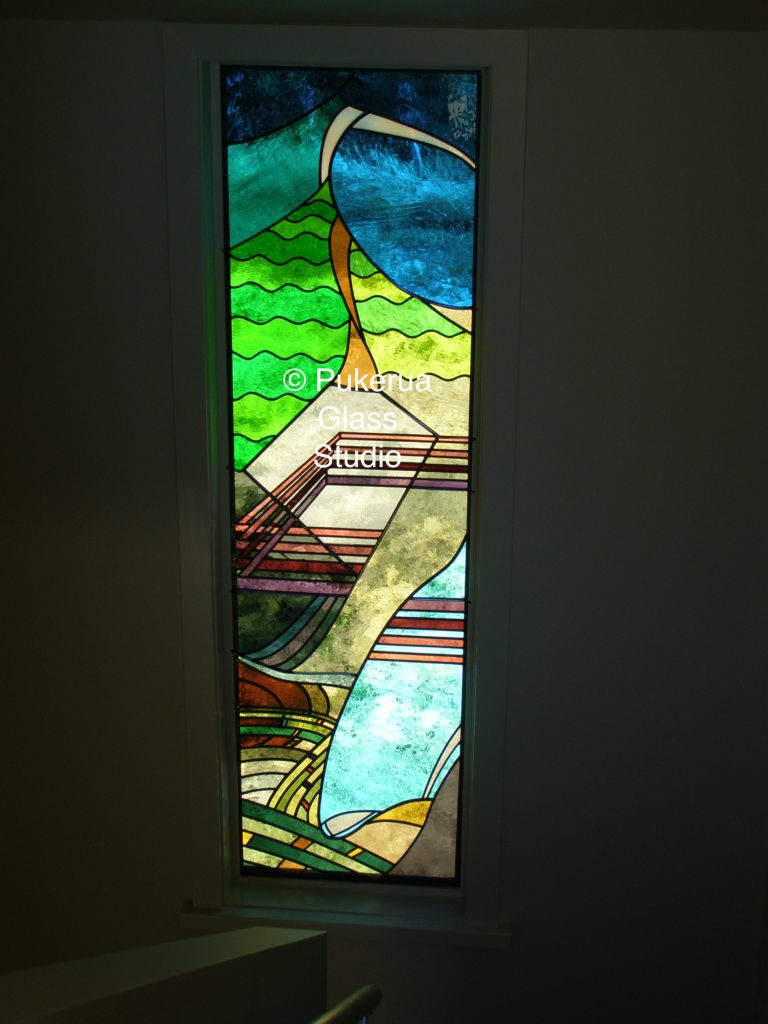 Stained glass panel interpreting local landscape