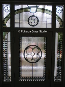 Stained glass door panel and surround